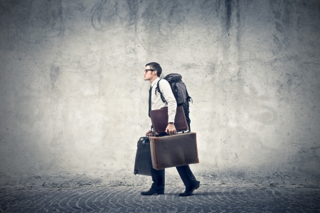 businessman with many suitcases walking  photo