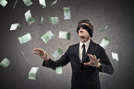 confused person: blindfolded businessman looking for money