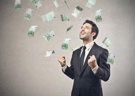 loteria: hombre de negocios feliz con su éxito económico Foto de archivo