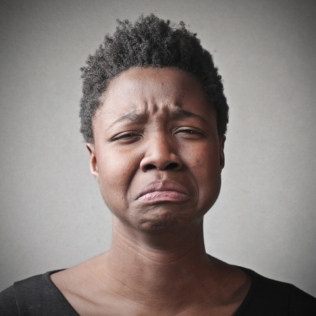 black woman portrait sad on gray background Stock Photo - 17546745