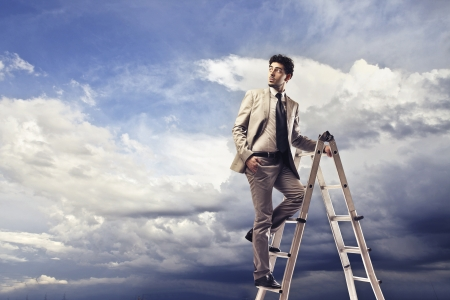 step ladder: businessman on a ladder looking into empty