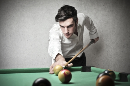 handsome young man playing pool photo