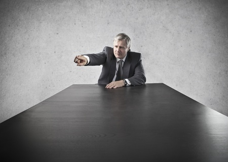 dismiss: head office sitting at desk orders  Stock Photo