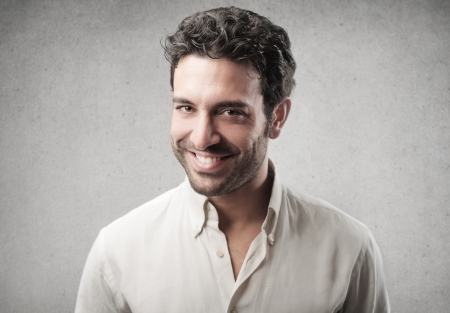 portrait of young man smiling on gray background Stock Photo - 17546651