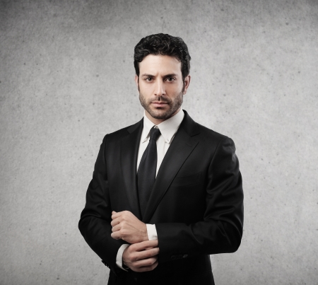 man of business: businessman elegant half-length on gray background