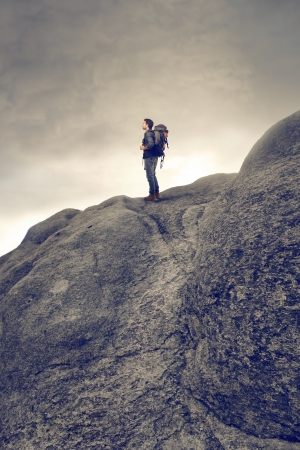 young man with backpack on top of the mountain Stock Photo - 17602387