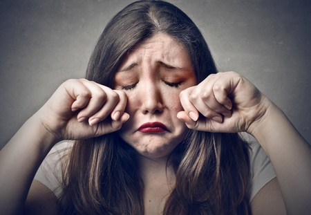 sad young woman crying photo