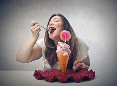 beautiful fat woman eating icecream