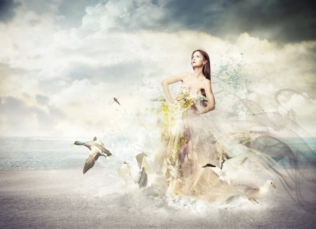 plume: beautiful young woman with elegant long dress on the beach