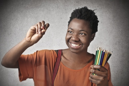 happy young black woman with colored pencils Stock Photo - 17664592