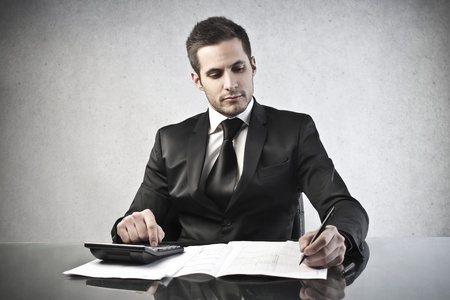 pay desk: businessman working at his desk