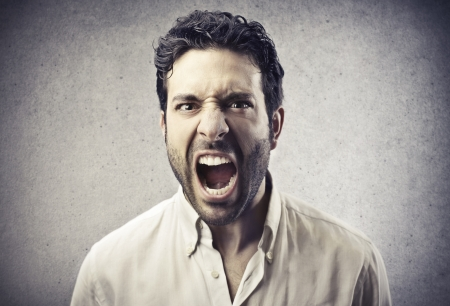 despair: furious young man shouting Stock Photo