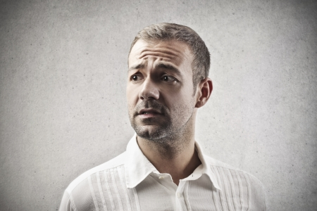 fear face: portrait of worried man