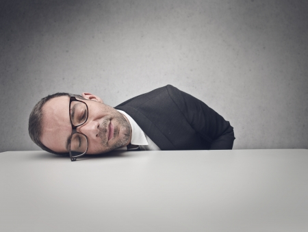 lazy: young businessman sleeping on the table Stock Photo