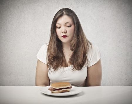 beautiful fat woman looking hot dog photo