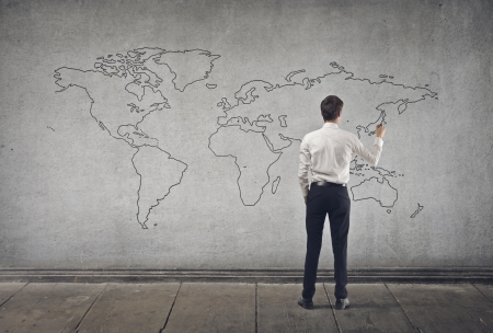 young businessman writes on the map photo
