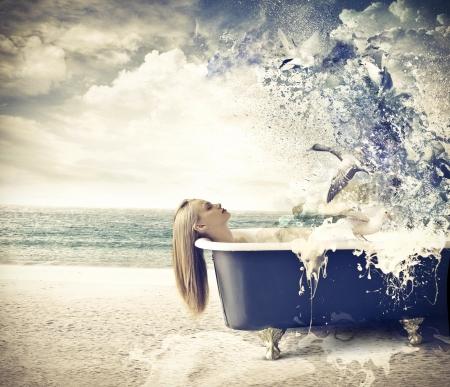 beautiful woman bathing on the beach photo