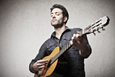 guitar player: musician playing guitar