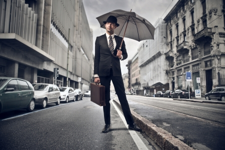 young businessman with umbrella in the city