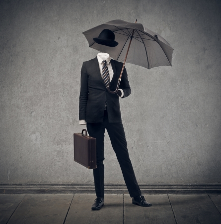 to exist: invisible businessman with hat and umbrella