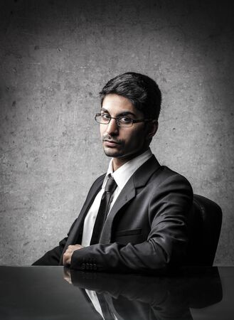 young businessman sitting at the table Stock Photo - 18099386