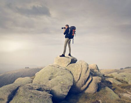 photographer takes a picture of landscape photo