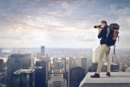 photographer takes a picture from the top of the city photo