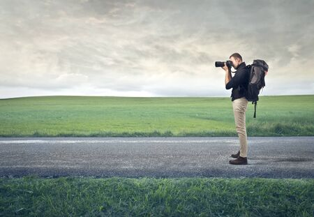 tele: photographer takes a picture on the road