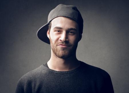visage homme: jeune garçon avec chapeau Banque d'images
