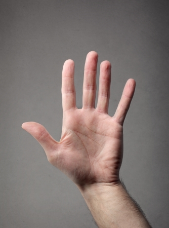 hand on gray background