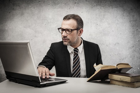 young businessman working at his desk Stock Photo - 18294873