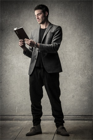 young man reads a book Stock Photo - 18294869
