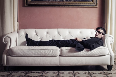 young businessman sleeping on the sofa photo