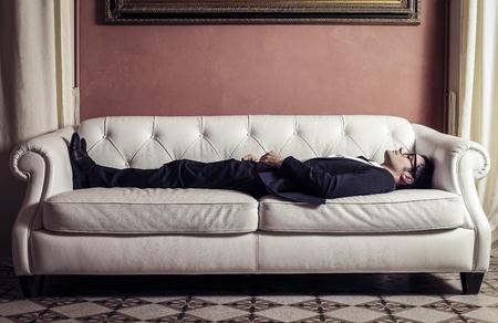 young businessman sleeping on the sofa Stock Photo - 18294879