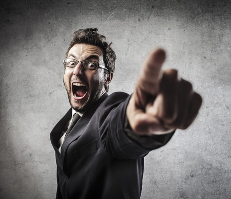 indicate: angry businessman screaming Stock Photo