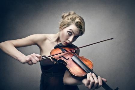 woman violin: beautiful blonde woman playing violin