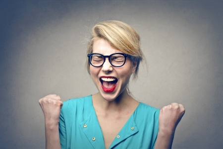woman screaming: portrait of blonde happy woman with glasses Stock Photo