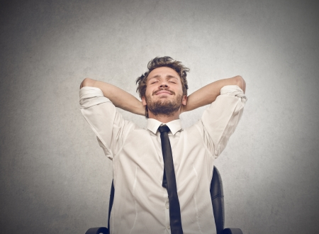 and relax: happy businessman relaxes Stock Photo