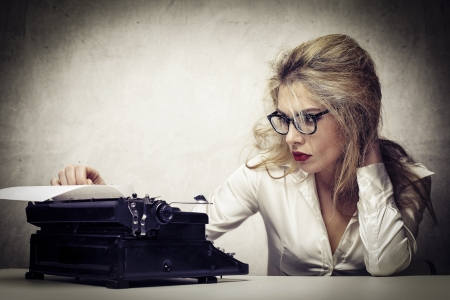 journalist: young journalist with typewriter Stock Photo