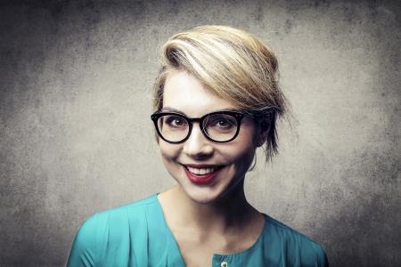 geek: portrait of smiling blonde woman Stock Photo
