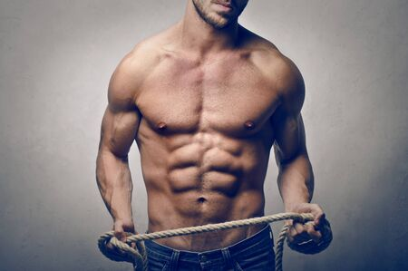 male torso: muscular man with rope