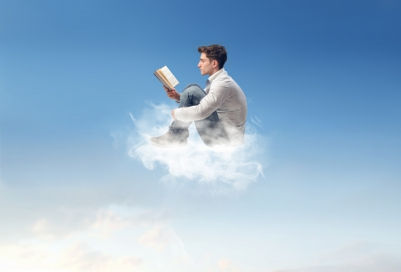 read: young man reads on a cloud in the sky