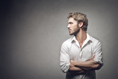 profile of handsome man on gray background photo