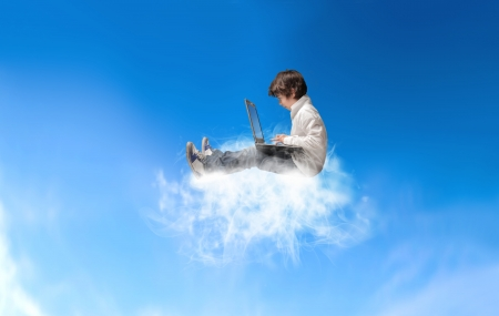 little child with laptop sitting on a clound in the sky Stock Photo - 18539392