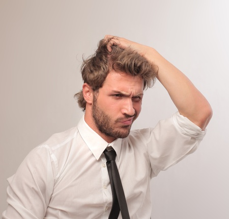 tired man: young confused businessman Stock Photo