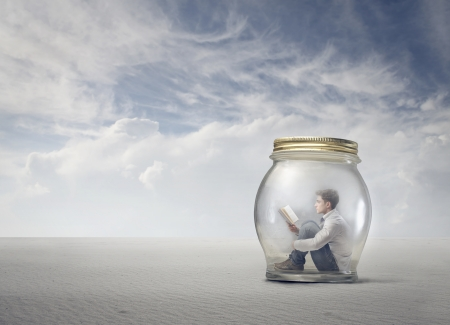 young boy reads book sitting in a jar Stock Photo - 18539378