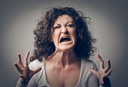 aggressive people: furious woman screaming  Stock Photo