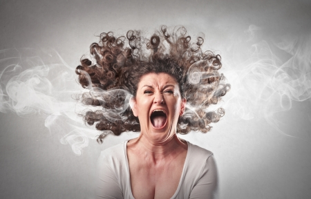 bad hair: furious woman screaming with smoke coming out of her ears