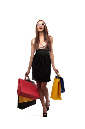 goes: happy woman goes shopping Stock Photo