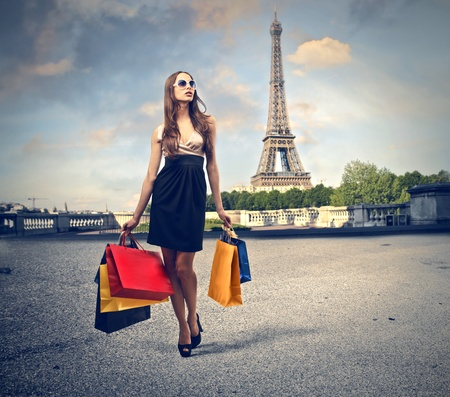 beautiful woman goes shopping in Paris photo